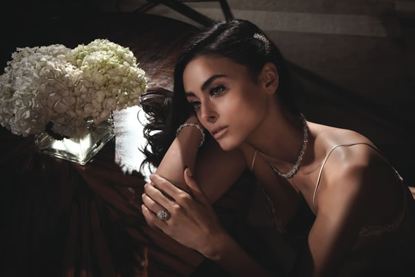 Diamond crescent brooch (in hair), $140,000, sunflower necklace, $164,000, and bracelet, $101,000, diamond cluster ring, $94,000, all at Harry Winston, South Coast Plaza; champagne camisole, $312, at La Perla, South Coast Plaza.