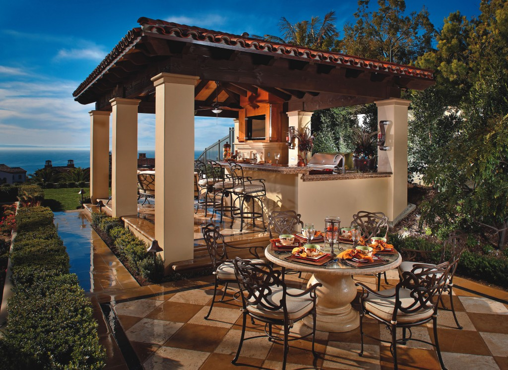 Backyard kitchens can include everything from a separate area for cooking, dining and drinking to multifunctional pizza ovens and full-size grills for preparing large family meals.