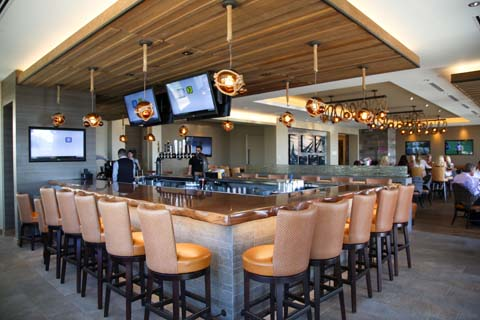 Horseshoe-shaped bar surrounded by TVs