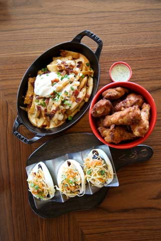 Beer batter fries, chicken wings and pork belly steamed buns